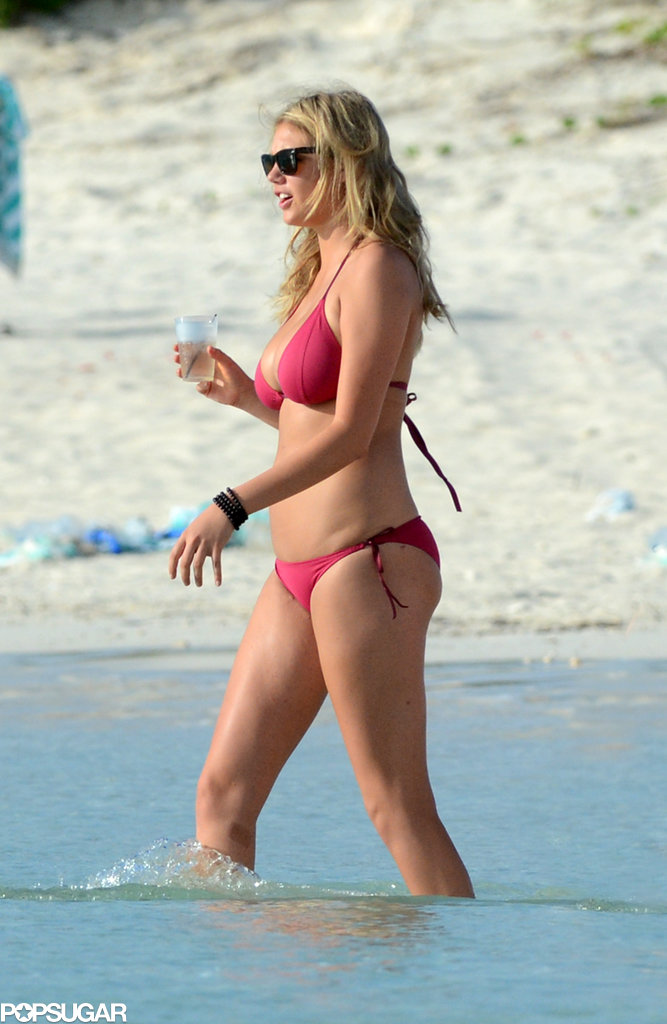 Kate Upton flaunted her bikini body in a berry-hued triangle suit in the Bahamas. If you want to reveal your figure, then go for a similar style.