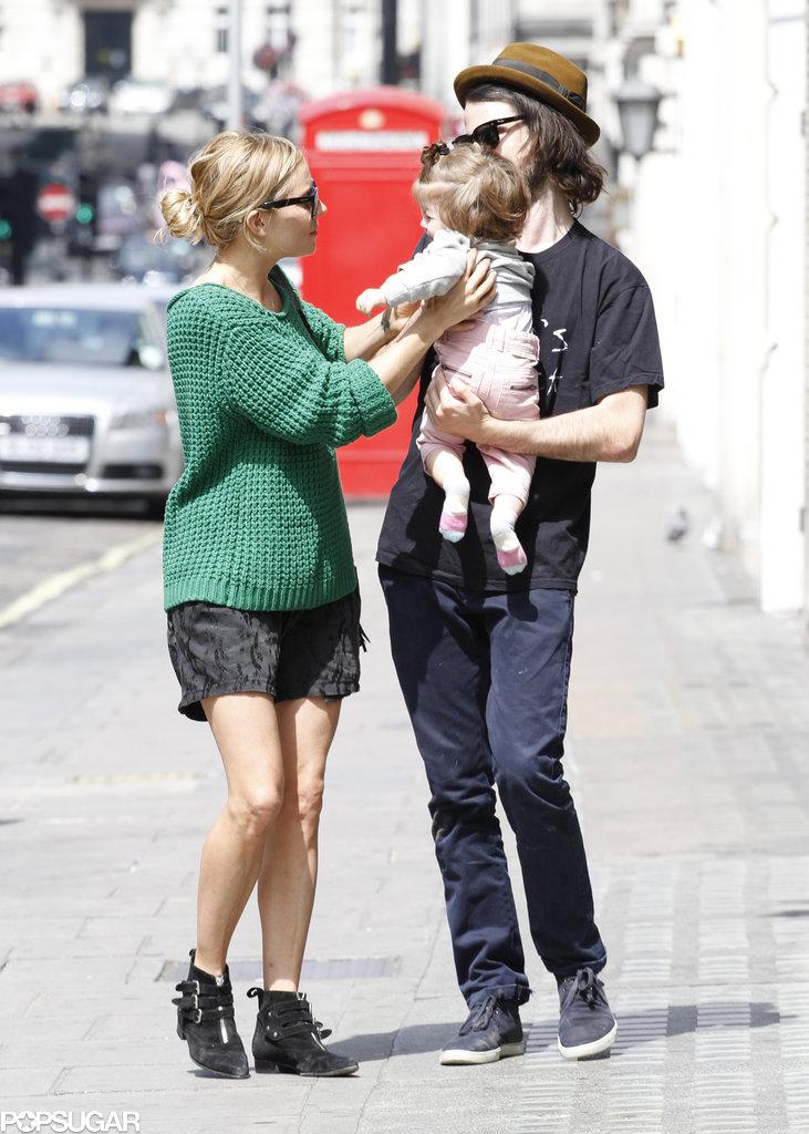 Sienna Miller handed her daughter, Marlowe, to Tom Sturridge.