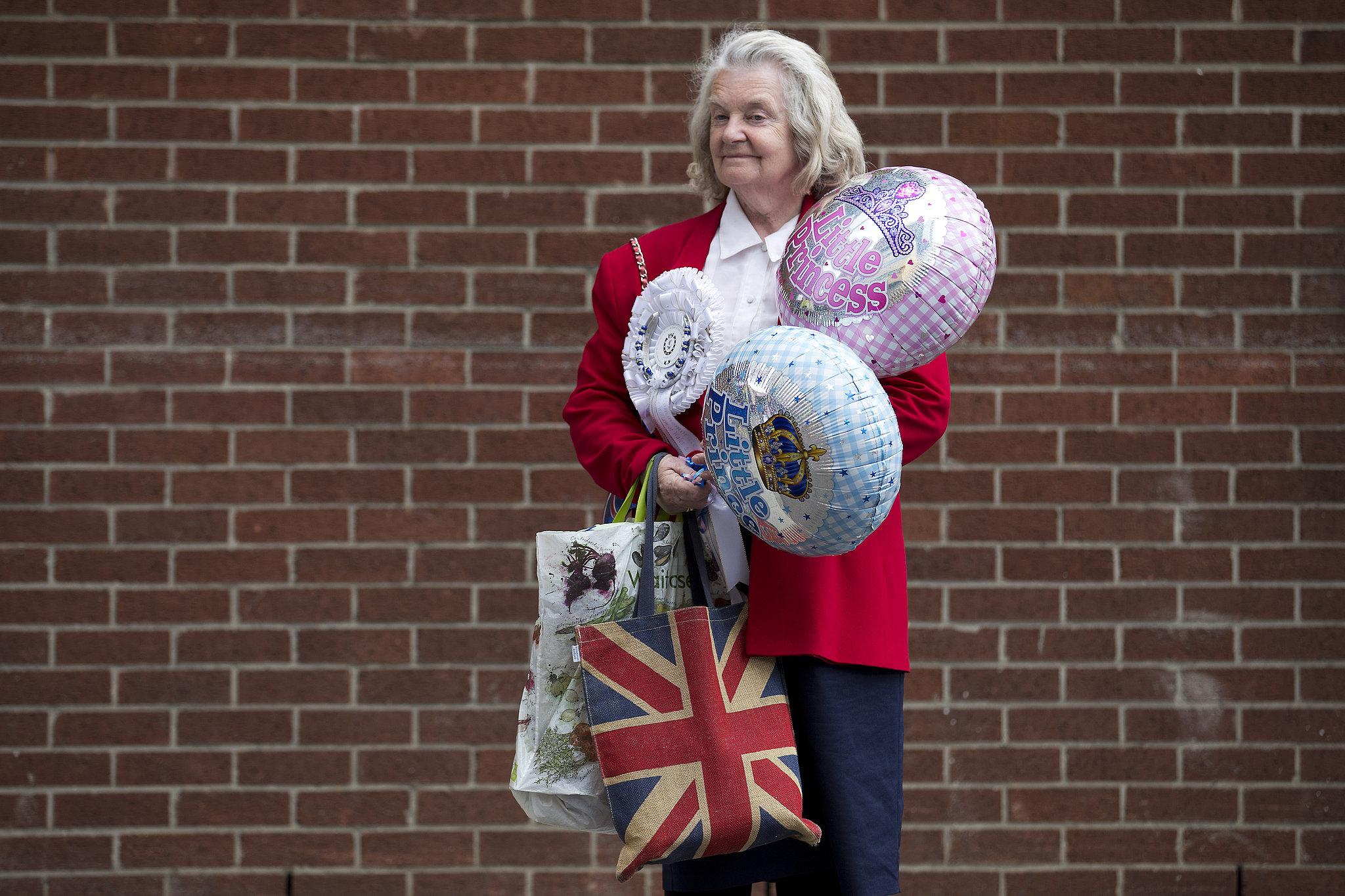 A royal fan stood outside the hospital.