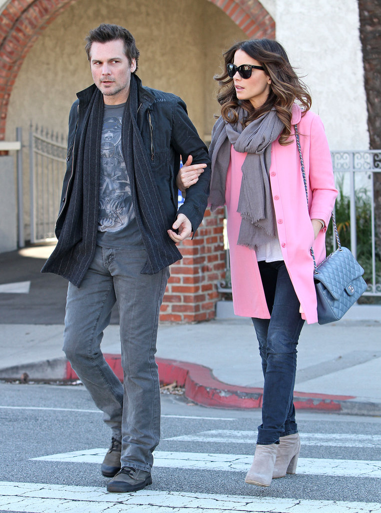 The actress strolled LA with her husband, Len Wiseman, in a pretty pink coat, stone-wash denim, and a quilted chain-strap Chanel bag in February 2013.