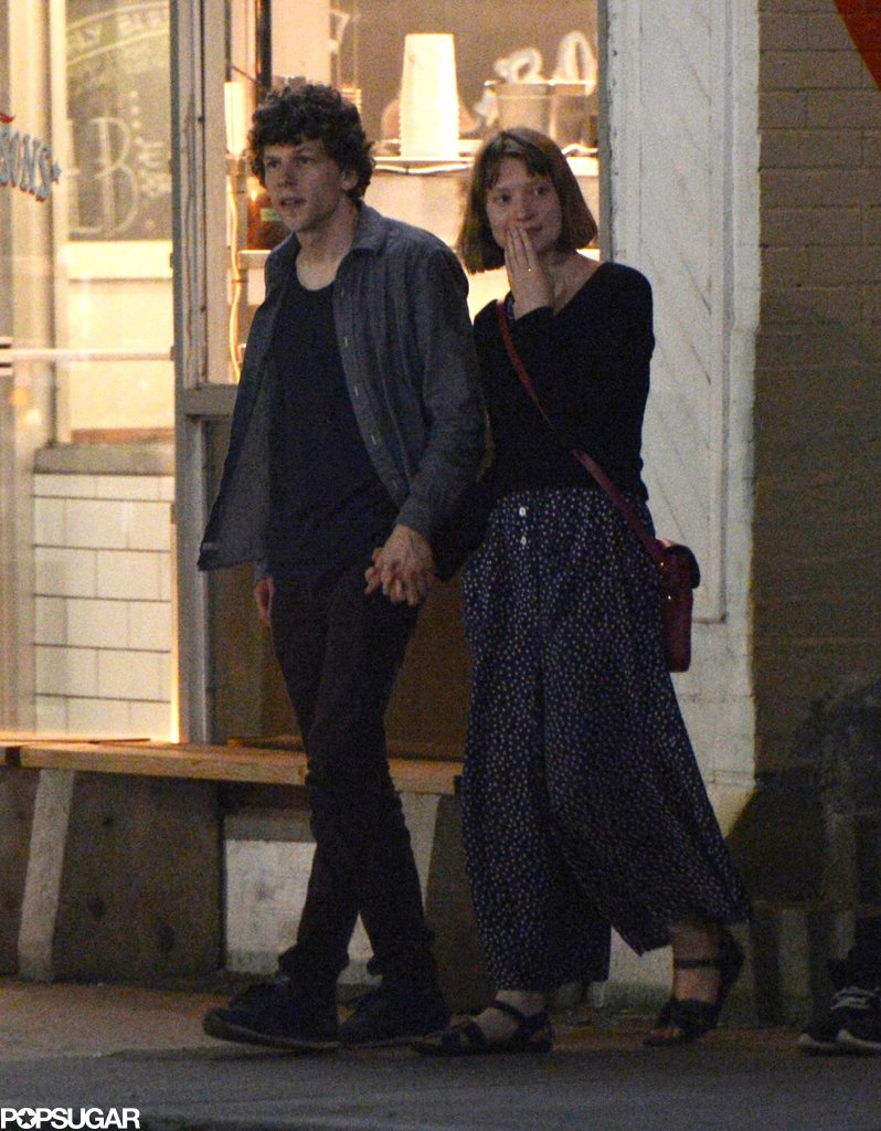 Jesse Eisenberg and Mia Wasikowska held hands for a night out with Robert Pattinson in Toronto.