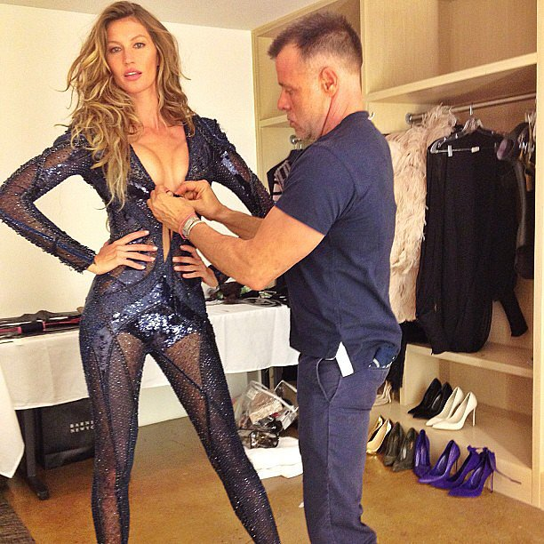 Gisele Bündchen showed off her sexy side while getting fitted in a Versace jumpsuit. Source: Instagram user giseleofficial
