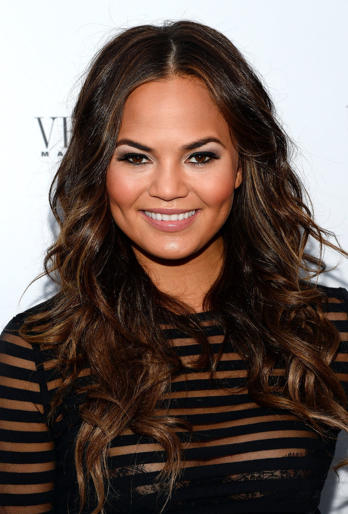 Chrissy Teigen hosted her Vegas magazine cover party at the Palazzo in a sexy black ensemble, which she wore with beachy waves and a gray smoky eye.