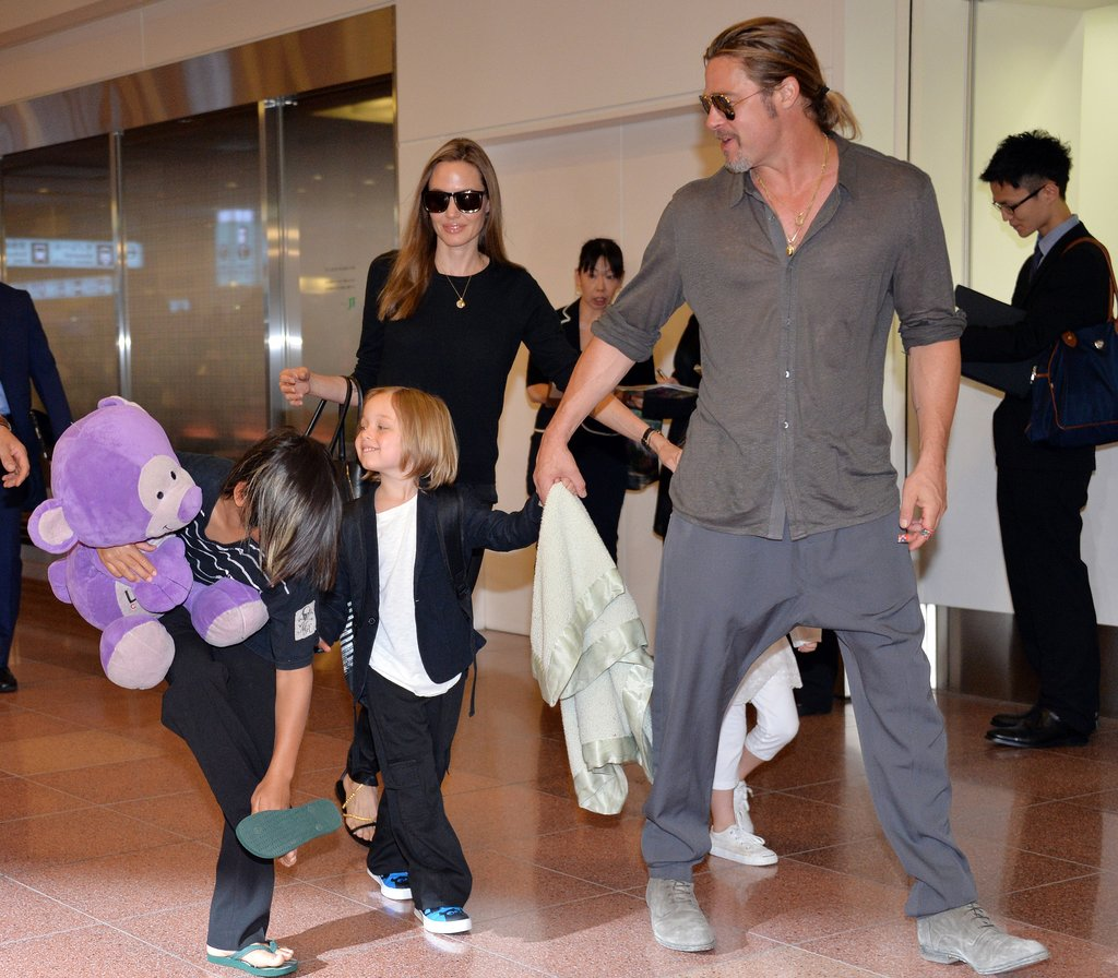 Angelina Jolie and Brad Pitt walked through the Tokyo airport with Pax, Vivienne and Knox.