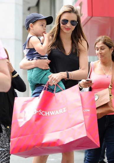 Miranda Kerr picked up items at a toy store.