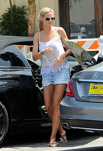 Heidi-Klum-matched-white-lace-tank-denim-cutoffs-during
