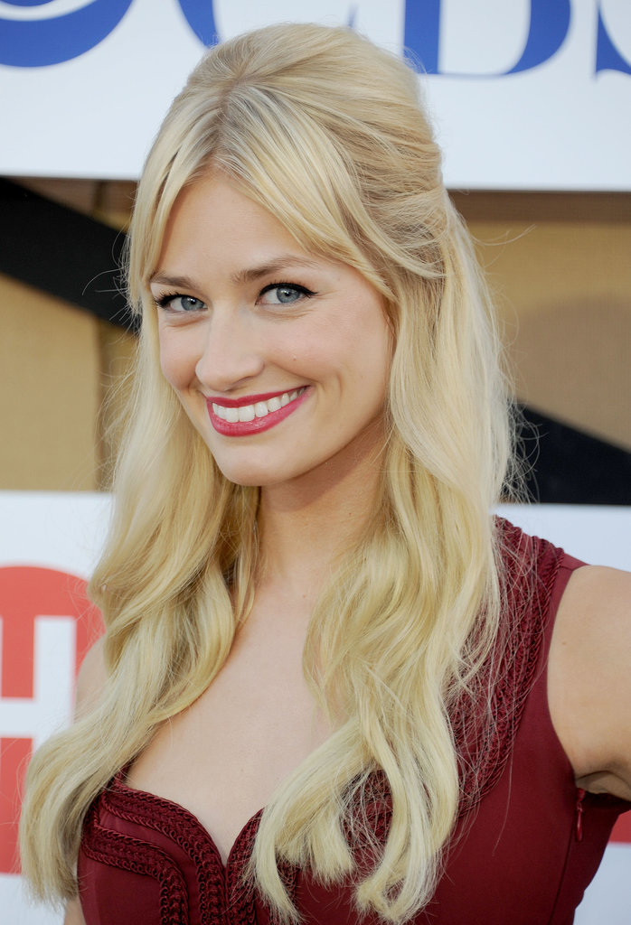Beth Behrs kept her bangs swept to the sides by parting them down the middle and pulling hair into a half-up hairstyle. The simple style looked even more flattering with her soft waves.
