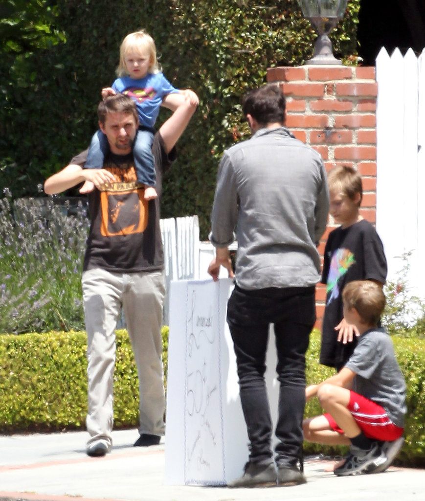 Matthew Bellamy carried his son Bingham on his shoulders while visiting Ryder's lemonade stand in LA.