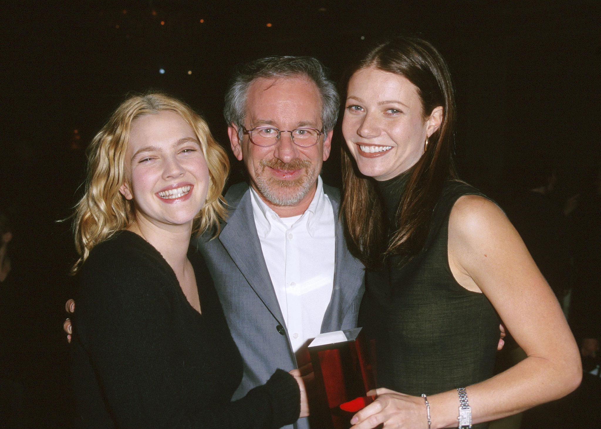 """. . . Steven Spielberg! The iconic film director is close friends with Gwyneth's parents, Blythe Danner and Bruce Paltrow, and was named as her godfather when she was born. Steven also has another A-list actress to call his goddaughter: Drew Barrymore. He helped Drew land her breakout role in E.T. the Extra-Terrestrial at just 7 years old, and when she posed for Playboy in 1995, Steven famously sent Drew a quilt for her 20th birthday with a note that read, """"Cover yourself up."""" In addition to her famous godfather, Drew's also got a legendary godmother in. . ."""