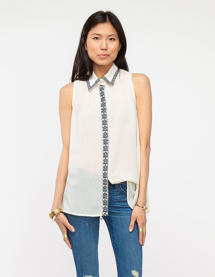 The classic white blouse is anything but simple with the extra details on this Need Supply Co. version ($48).