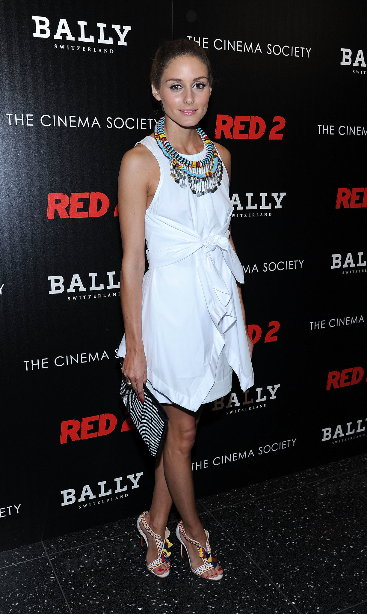 For NYC's Red 2 screening, Olivia dressed up her white Summer mini with colorful beads and a pair of eclectic heels.