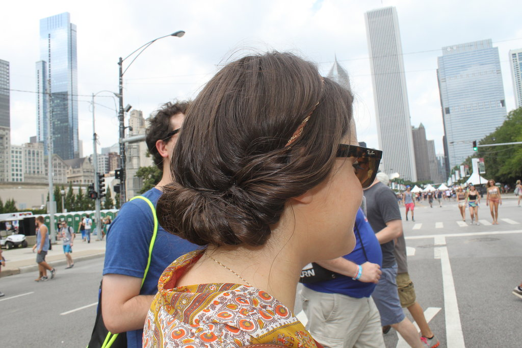 Headbands were the norm on the streets of Lollapalooza, but this festival attendee tucked her hair into an updo that's part chignon, part french roll.