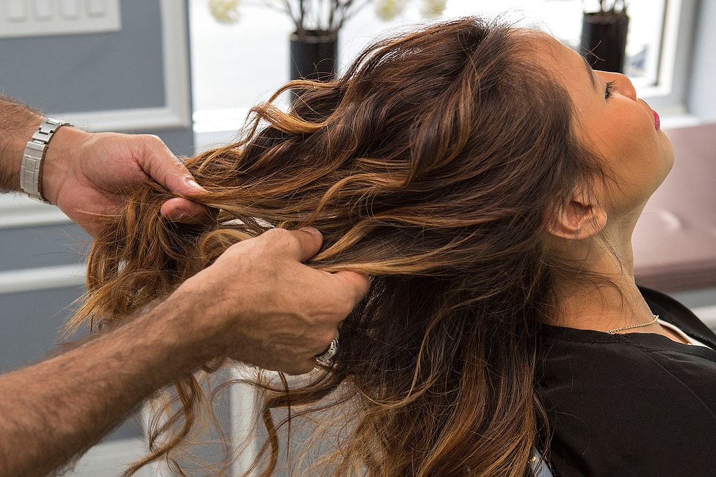 After your whole head is curled, go back and run your fingers through your hair. You want to loosen and break up the curls for a more casual, effortless feel.