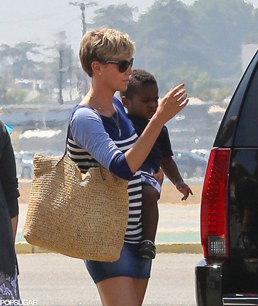 Charlize Theron held on to her son, Jackson, as she got ready to board a private plane in LA.