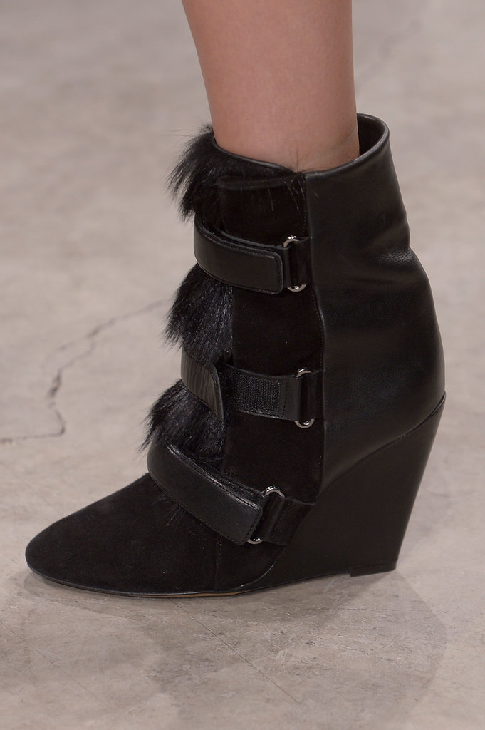 The runway showed off enough wedge boots to keep us happy straight through next Spring. Seen here, triple buckles make us think of the wedge sneaker's Velcro straps. Her latest ankle boot is polished and ready for grown-up life, especially with luxurious black fur detail.