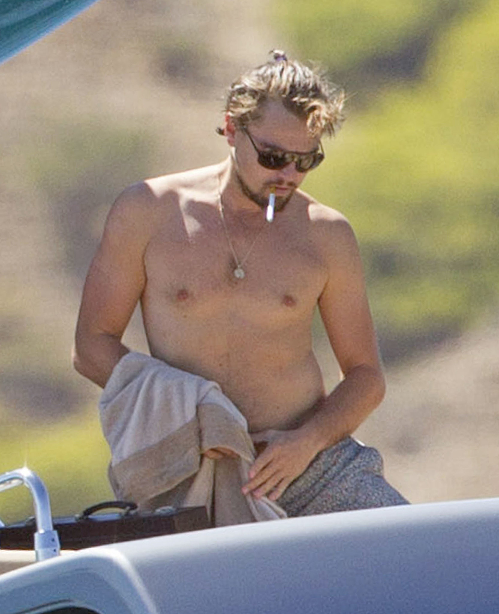 Leonardo DiCaprio went shirtless on a boat when he relaxed in Ibiza in August 2013.