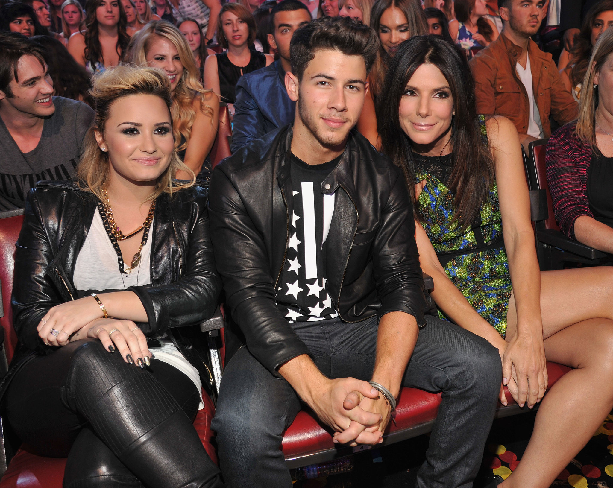 Demi Lovato, Nick Jonas, and Sandra Bullock sat together at the Teen Choice Awards.