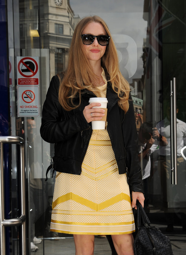 Amanda Seyfried wore a yellow dress and leather jacket out in London.