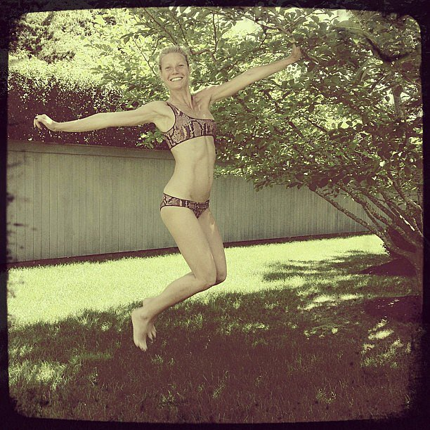 Gwyneth Paltrow jumped for joy in a snakeskin-print Stella McCartney bikini. Source: Instagram user stellamccartney