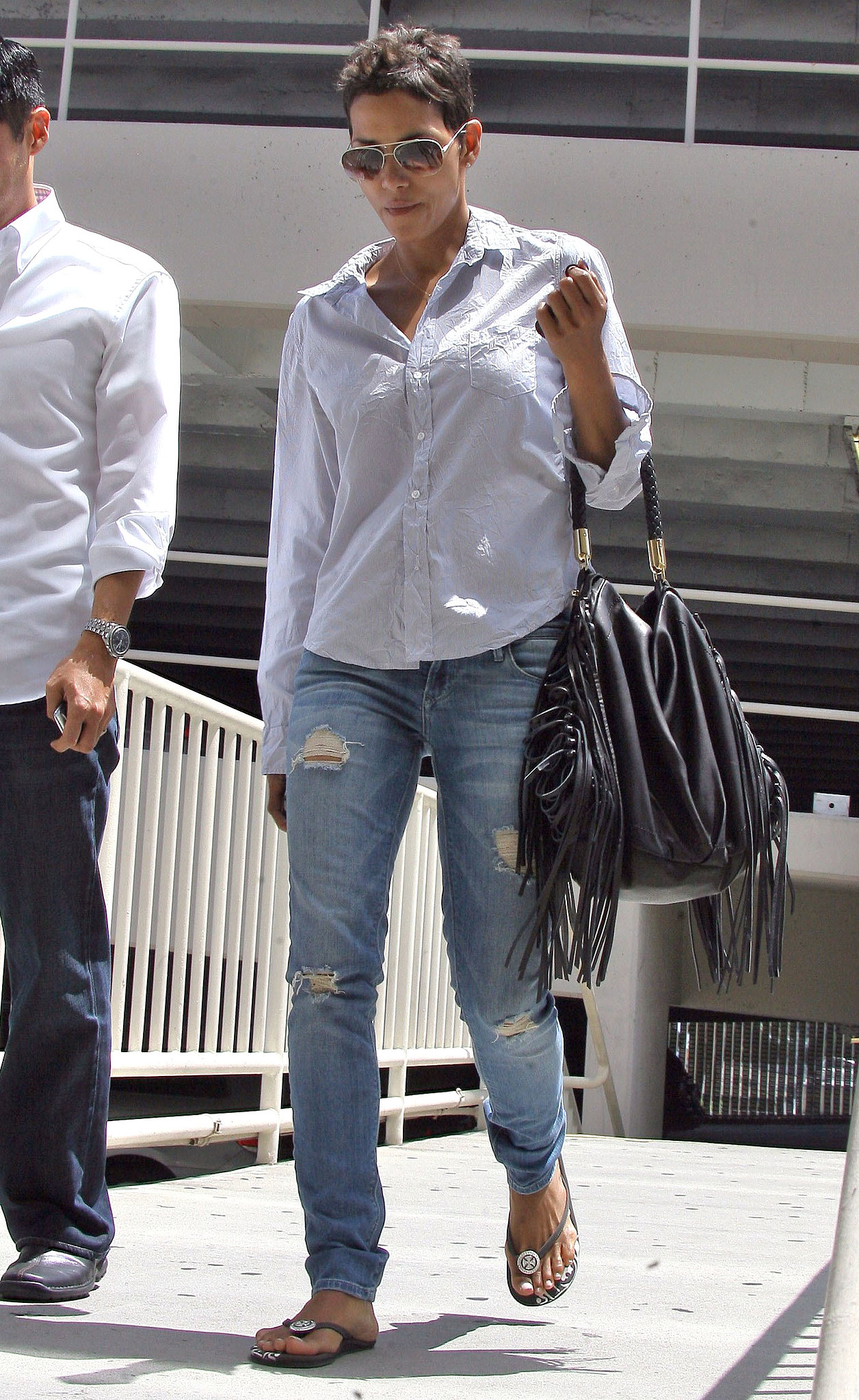 A wrinkled button-down and ripped jeans look sexy, not tired, on Halle.