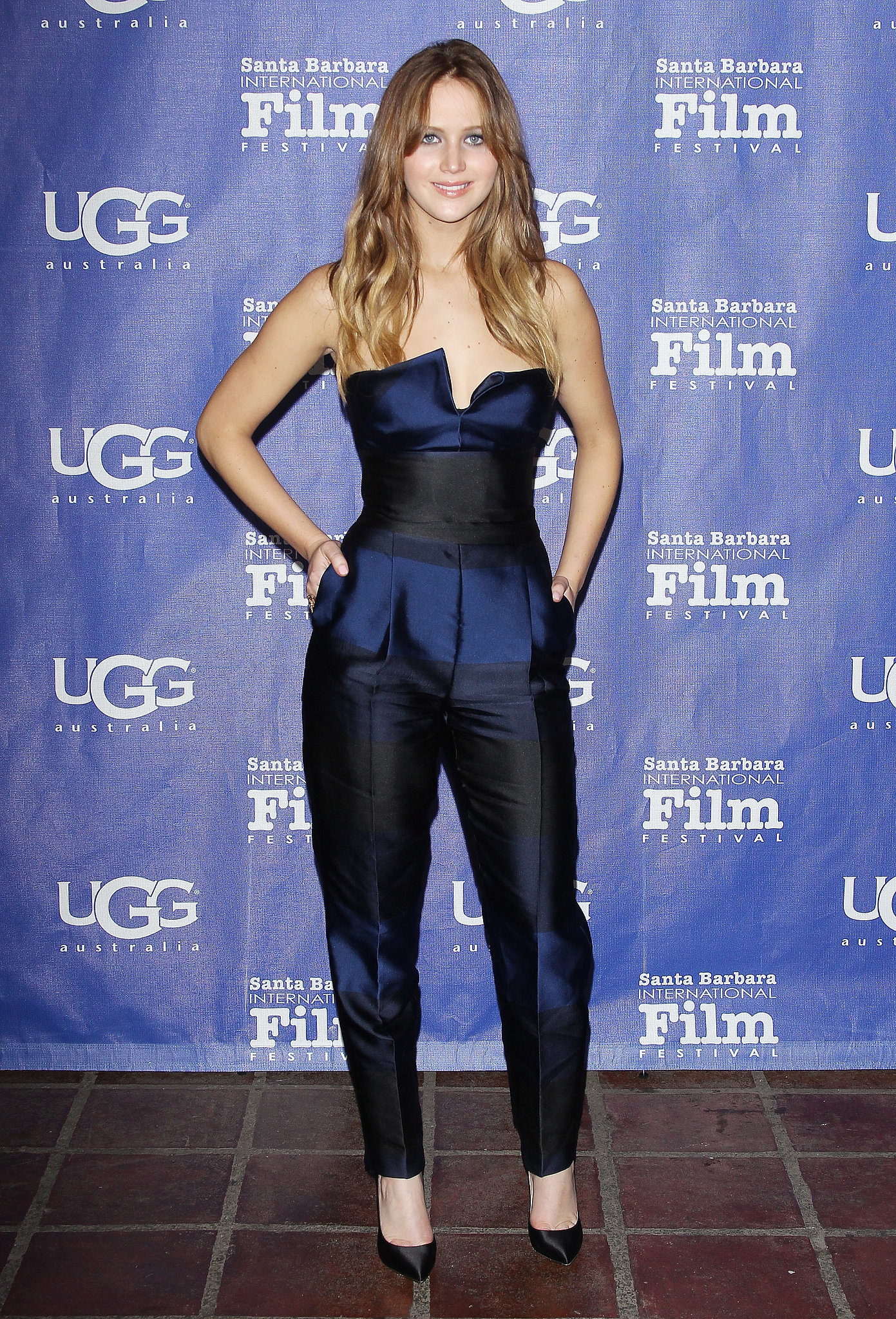 How fabulous does Jennifer Lawrence look in blue? We love how she edged things up a bit in this blue-and-black jumpsuit —extra points for the pleats.