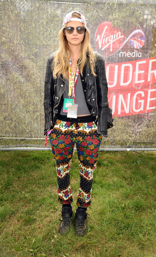 With all that grungy goodness, there's no mistaking Cara's signature style under that backwards cap, leather biker jacket and printed Minkpink pants at V Festival in Chelmsford.