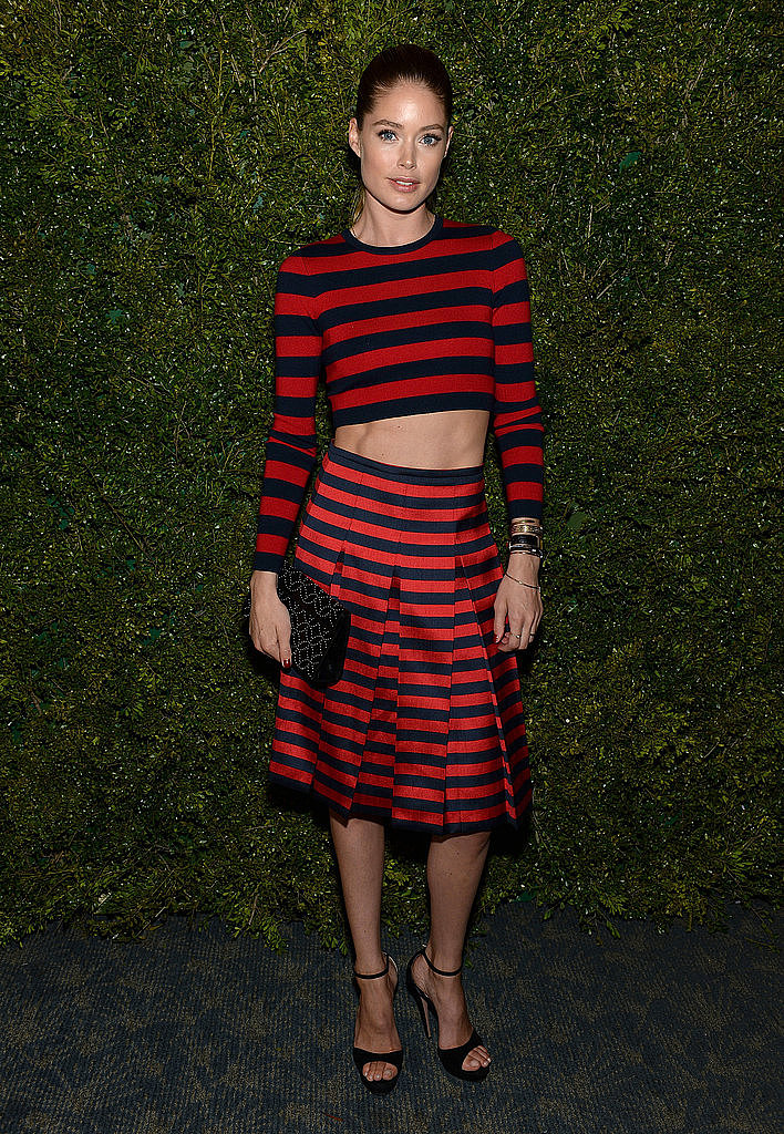 Doutzen Kroes got all striped out in a matching top and pleated skirt.