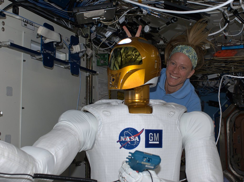 """""""If Robonaut wants to be a part of our team, he needs to take a little fun harassment! =) KN from space."""" Source: Pinterest user Karen Nyberg"""