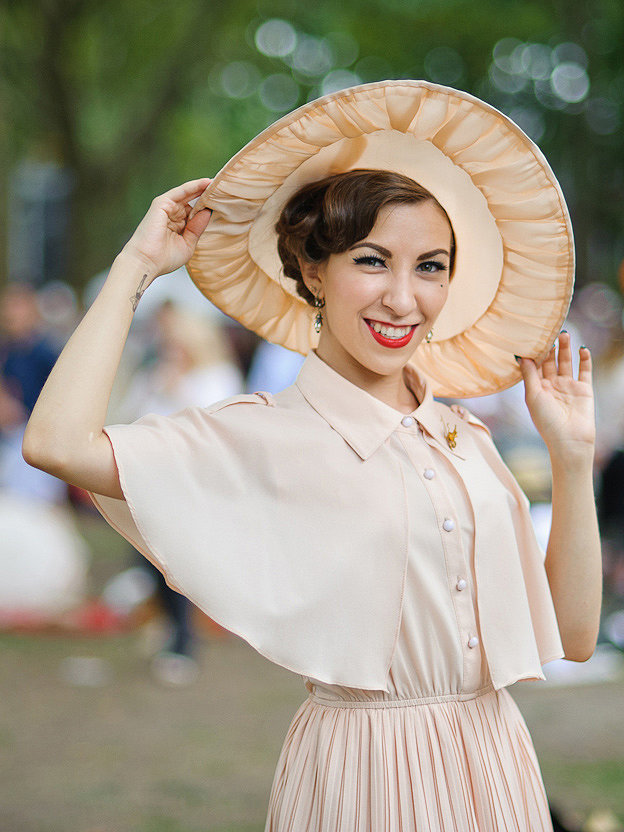 Forget neons and punchy citrus hues. Muted neutrals feel much more decade appropriate, as do this attendee's finger waves.  Photo: Jane Kratochvil