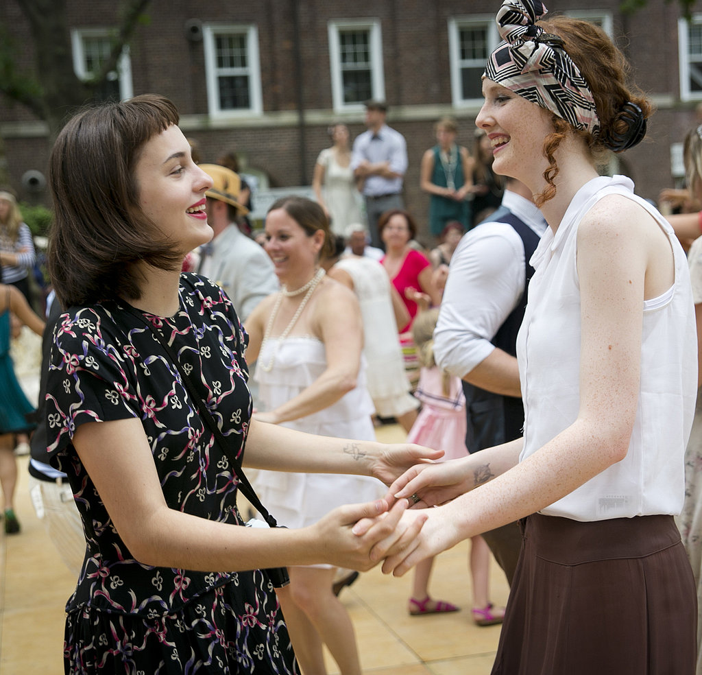 Two friends get to dancing with era-approved hair. We love the blunt bangs and tendrils escaping from her expertly tied kerchief.  Photo: Whitney Browne