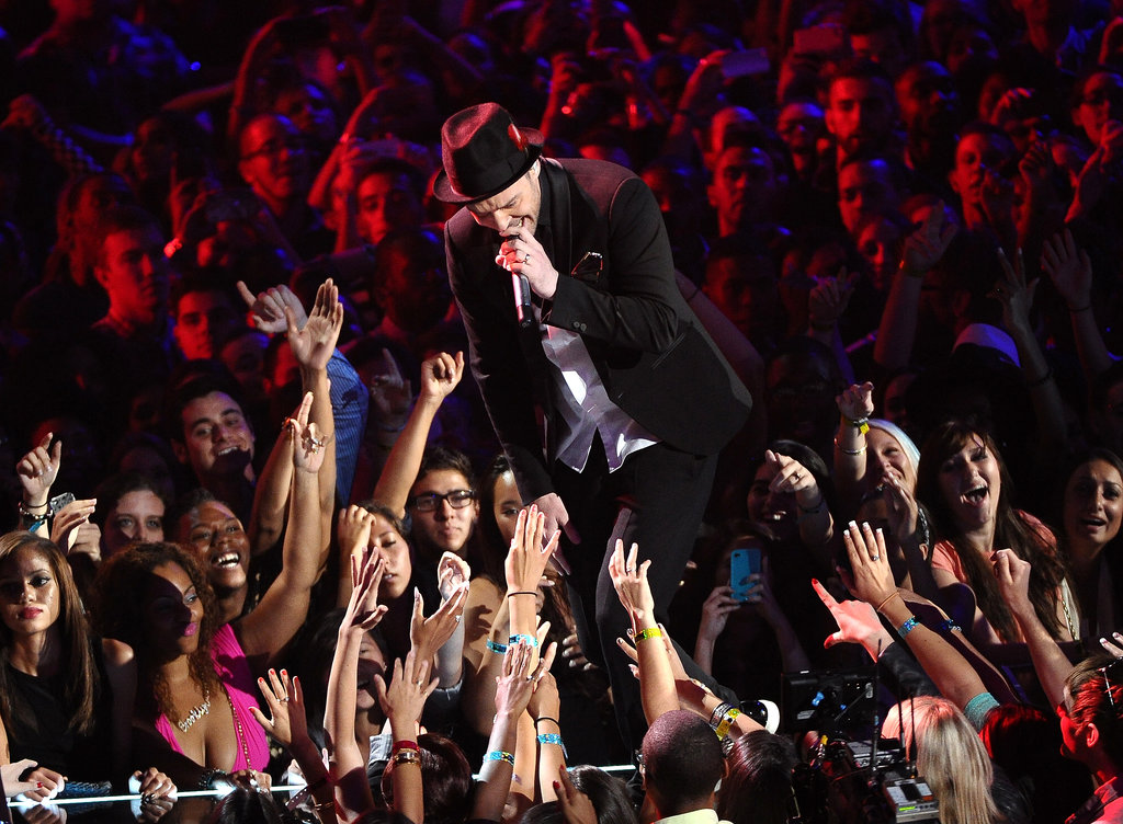 Justin Timberlake shook hands with fans during his VMAs performance.