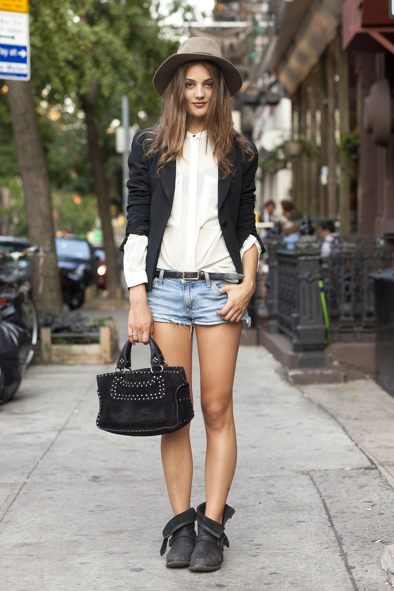 Give your cutoffs a Fall makeover with a blazer and autumnal accompaniments, like a hat and biker boots. Source: Le 21ème | Adam Katz Sinding