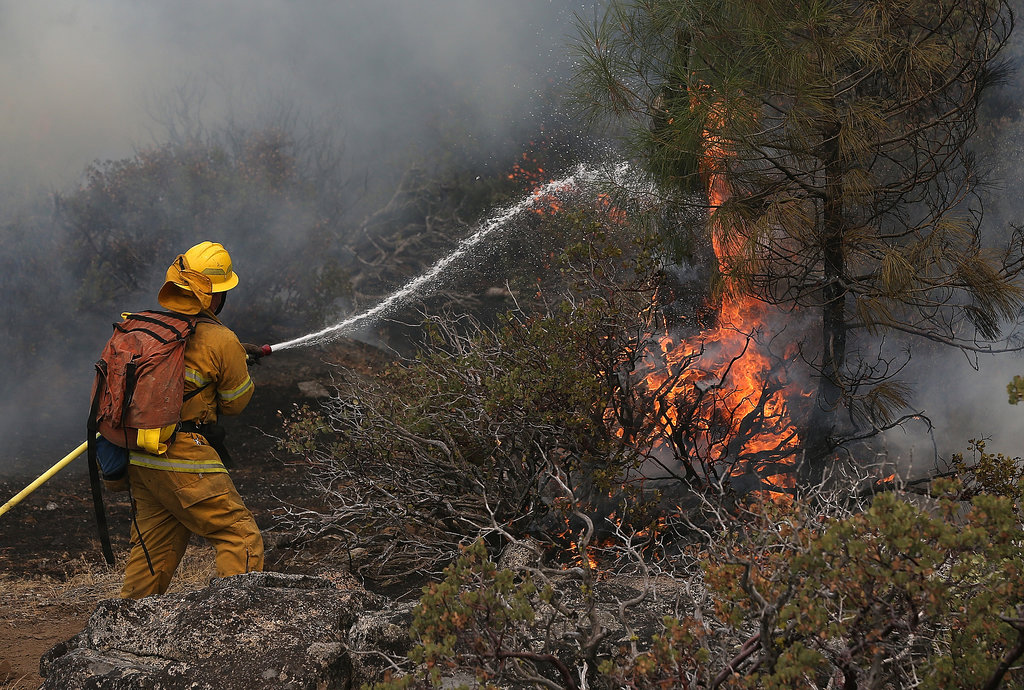 A firefighter used a hose to battle the flames.