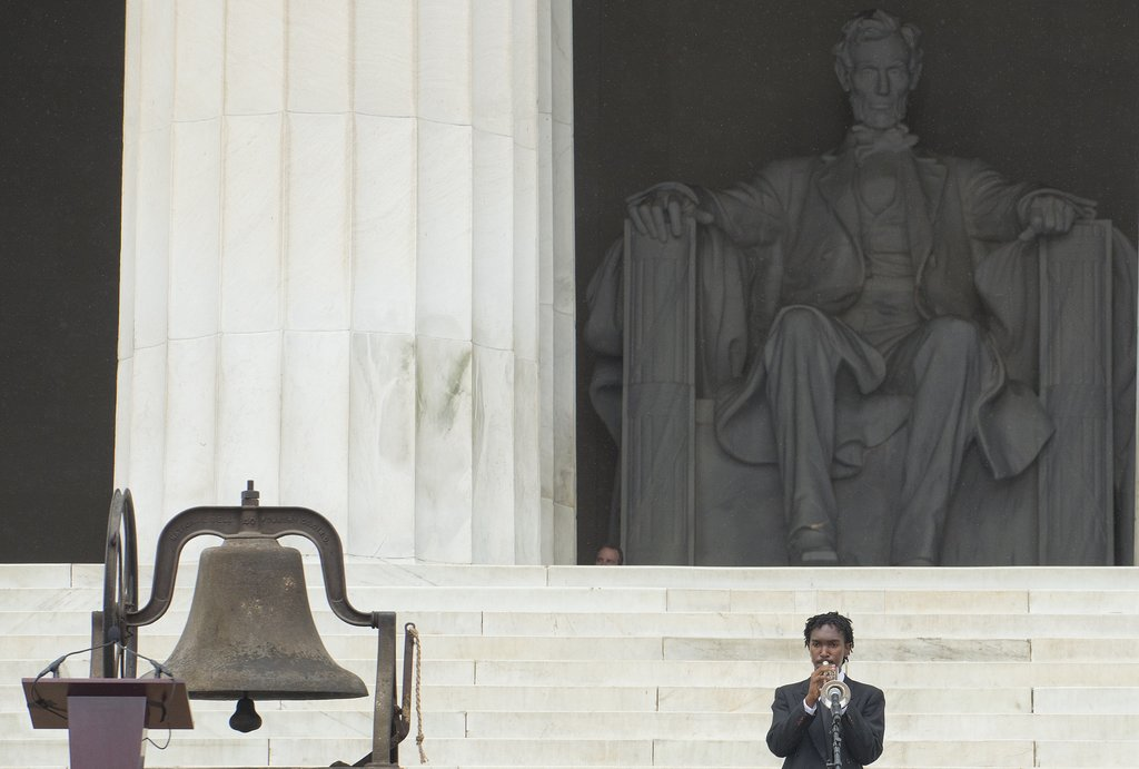 A trumpeter performed on the steps of the Lincoln Memorial.
