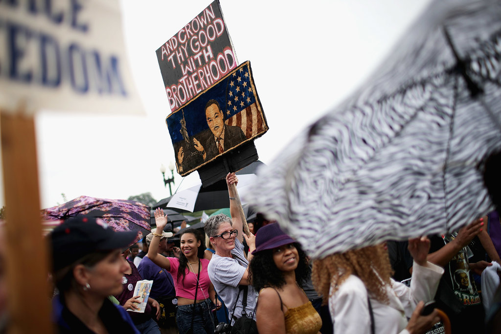 Signs representing freedom and Dr. Martin Luther King Jr. were held up during the march.