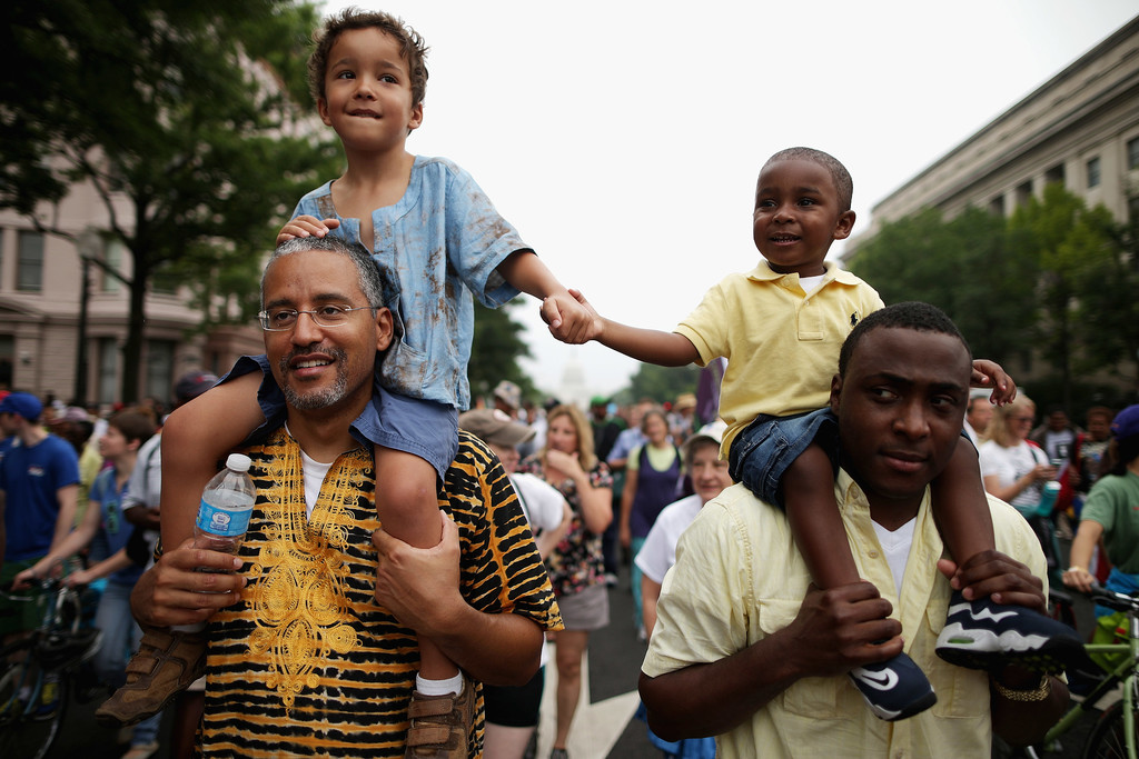 Two men and their sons marched together in Washington DC.
