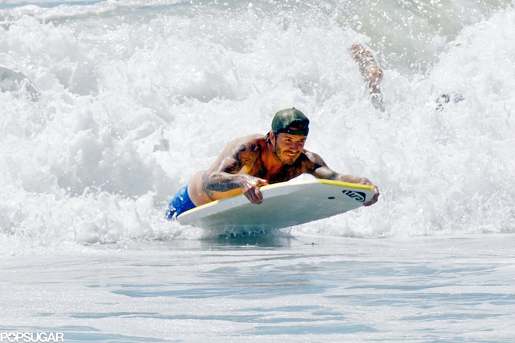 David Beckham surfed the waves on his boogie board.