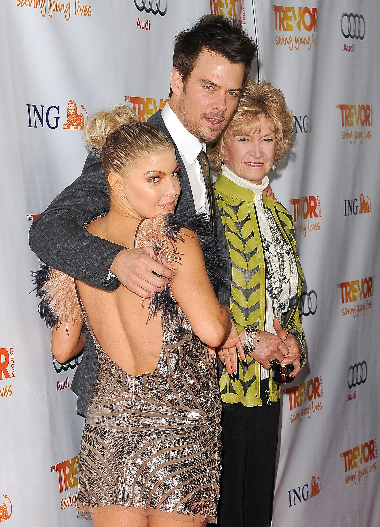Fergie and Josh Duhamel posed with Josh's mom, Bonny, at a charity event in LA in December 2011.