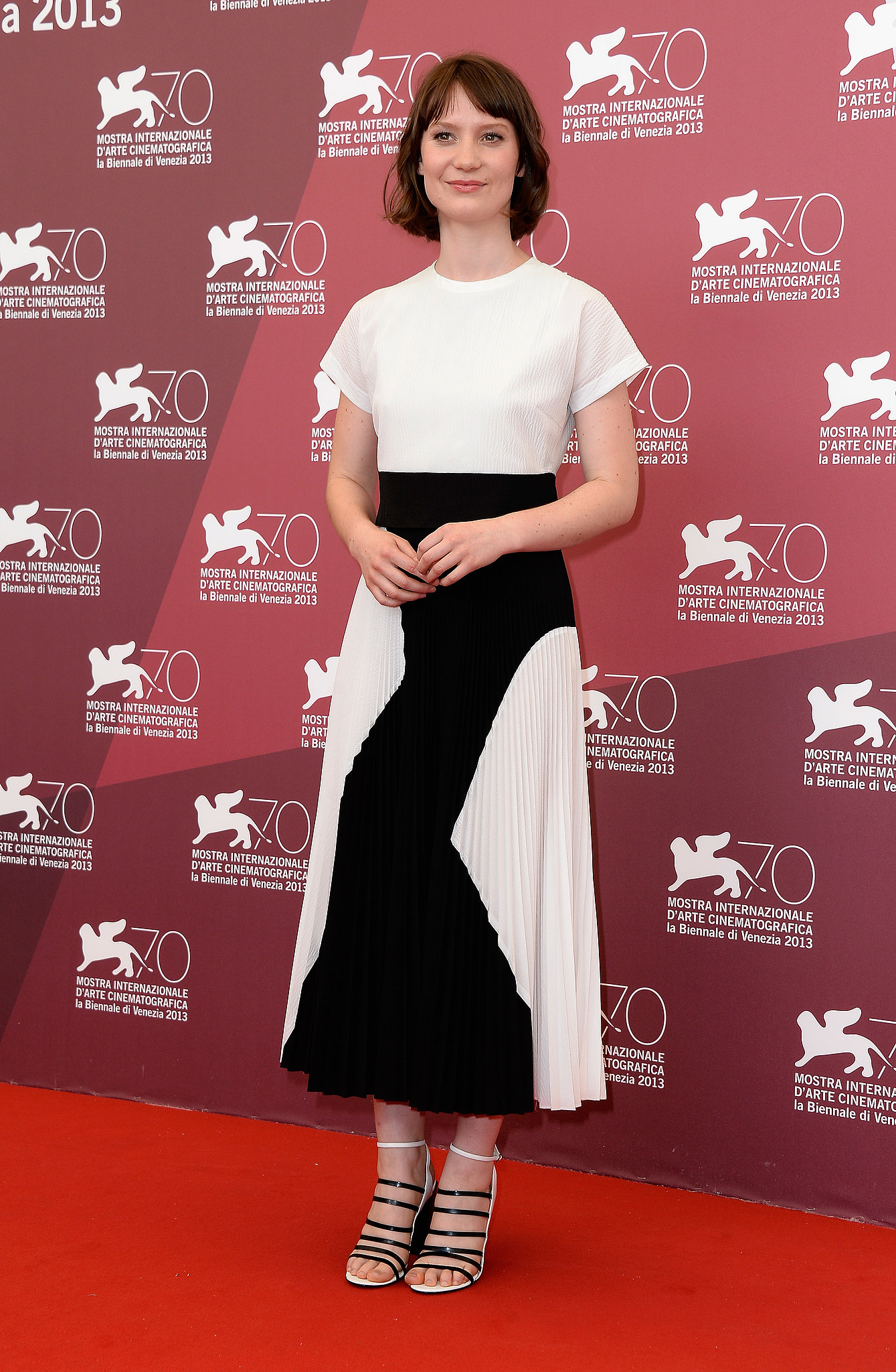 At the Venice Film Festival premiere of Tracks, Mia Wasikowska paired Proenza Schouler's cloque dress with strappy sandals.
