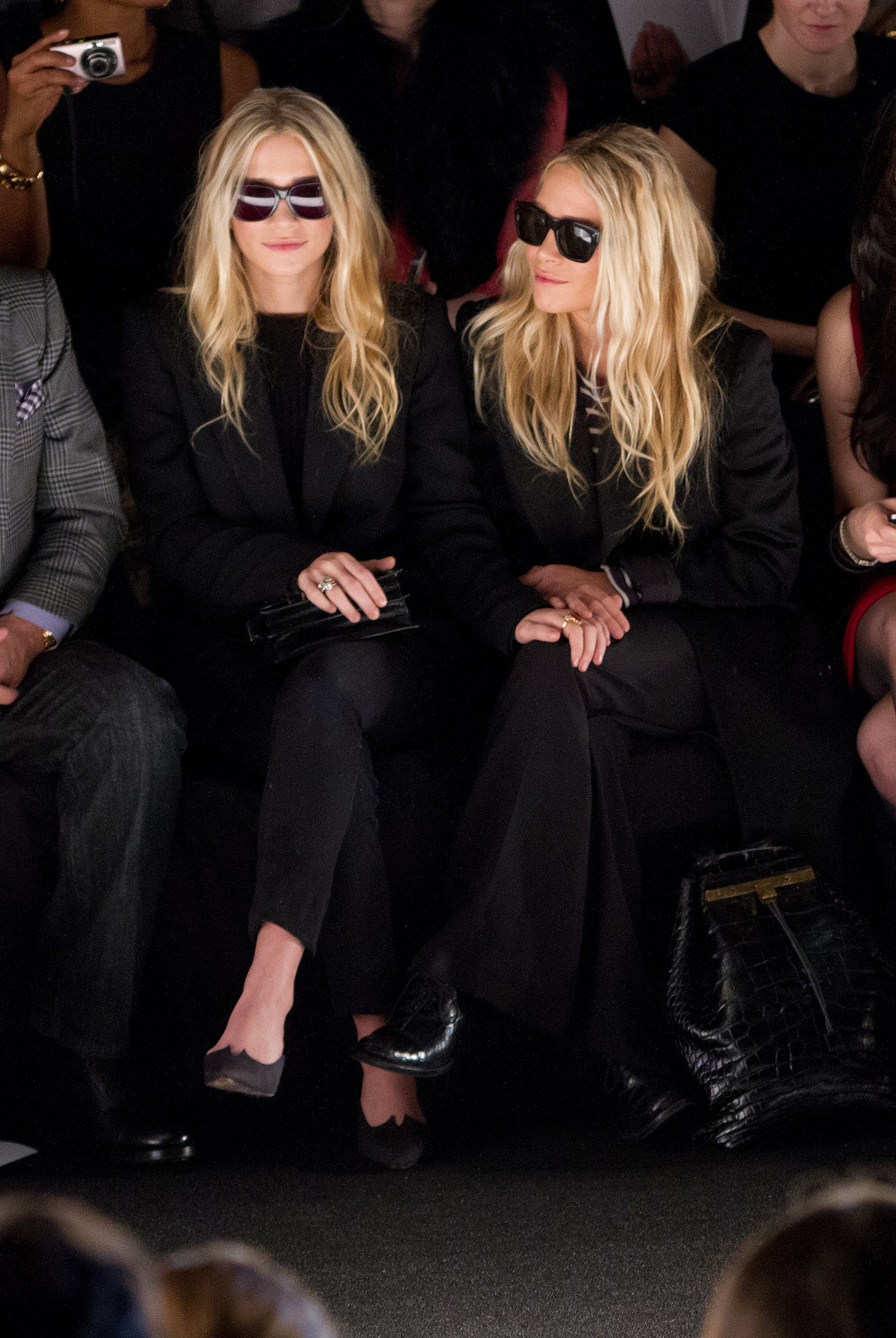 Mary-Kate Olsen and Ashley Olsen both wore sunglasses in February 2012 for J. Mendel's show.