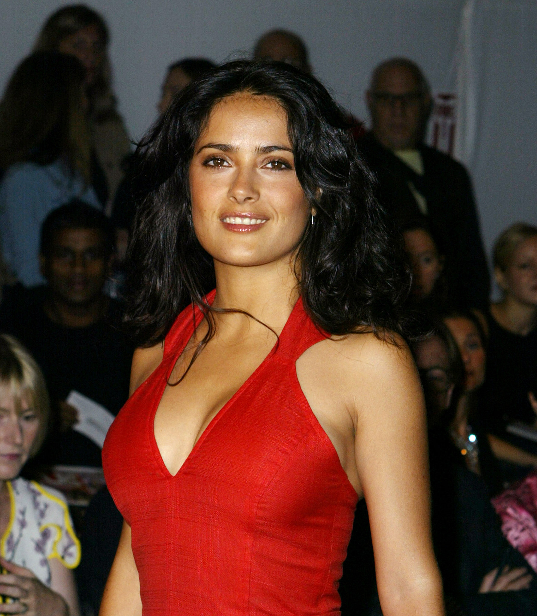 Salma Hayek wore a sexy red dress to Carolina Herrera's September 2003 show.