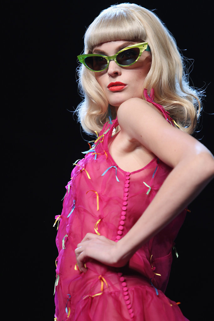 Galliano-era Christian Dior shows were always a spectacle, and for Spring 2010, that meant cat-eye sunglasses, bright red lips, and Bettie Page wigs.