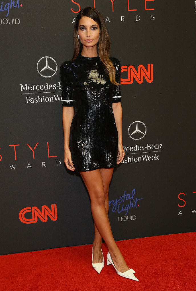 Lily Aldridge sparkled in a little black sequined Louis Vuitton minidress at the 10th annual Style Awards in NYC. She then added a mod touch via pointy white, square-heeled pumps.