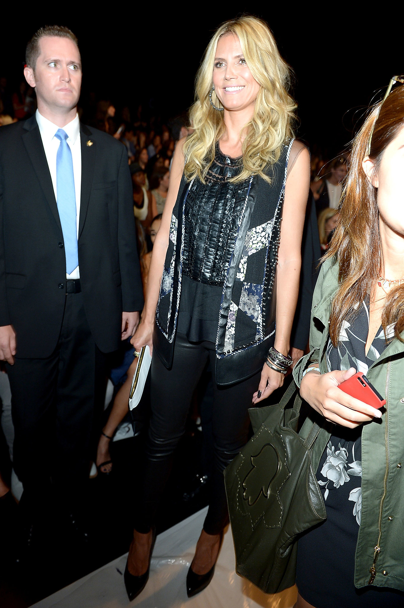 Heidi Klum worked a dark look in an embellished BCBG Max Azria vest with black leather skinny pants at BCBG.