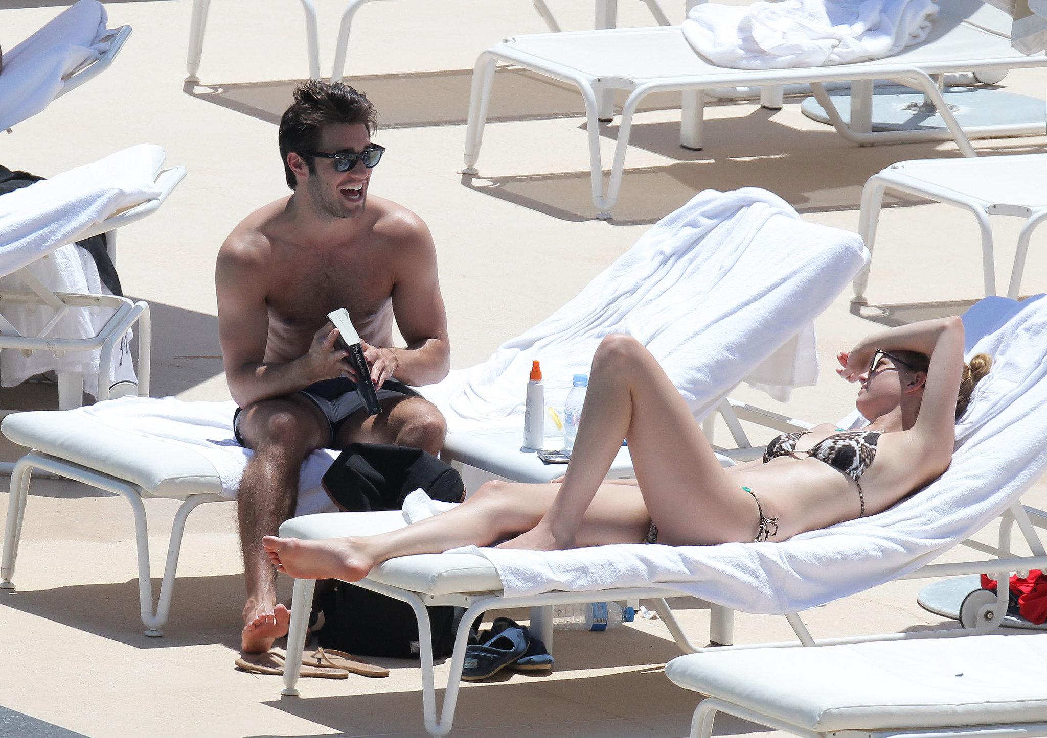 Emily VanCamp and Joshua Bowman lounged poolside in Monaco ...