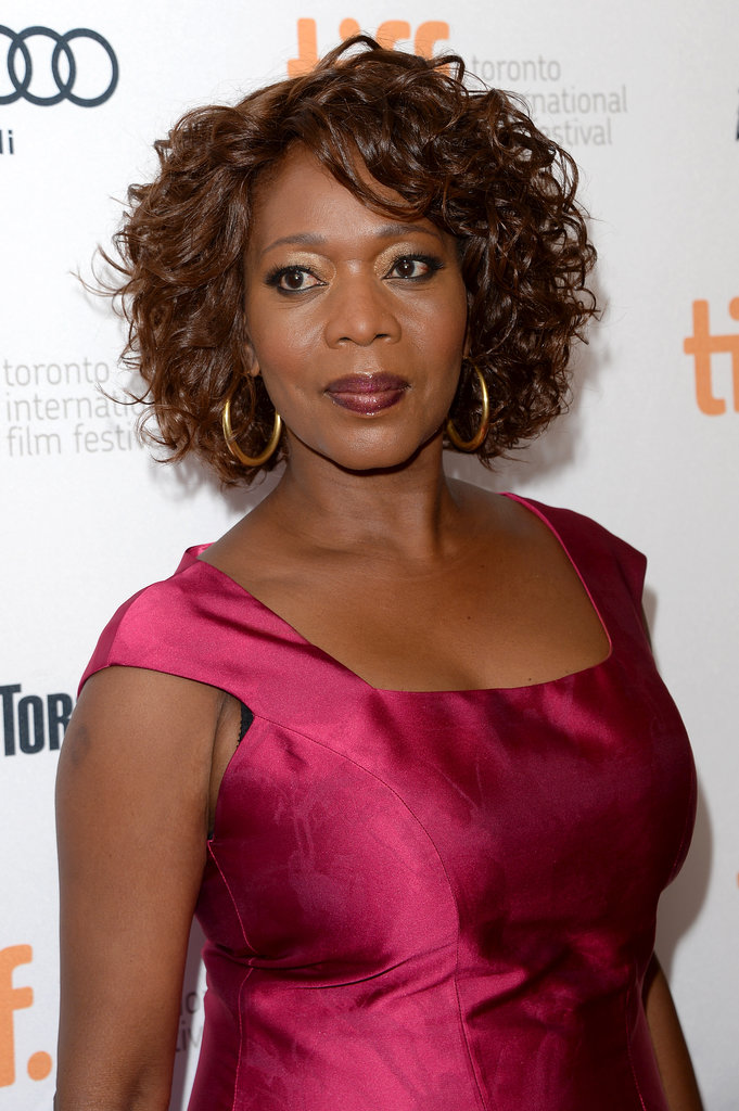 Alfre Woodard's garnet-hued lipstick perfectly matched her jewel-toned dress on the 12 Years a Slave red carpet.