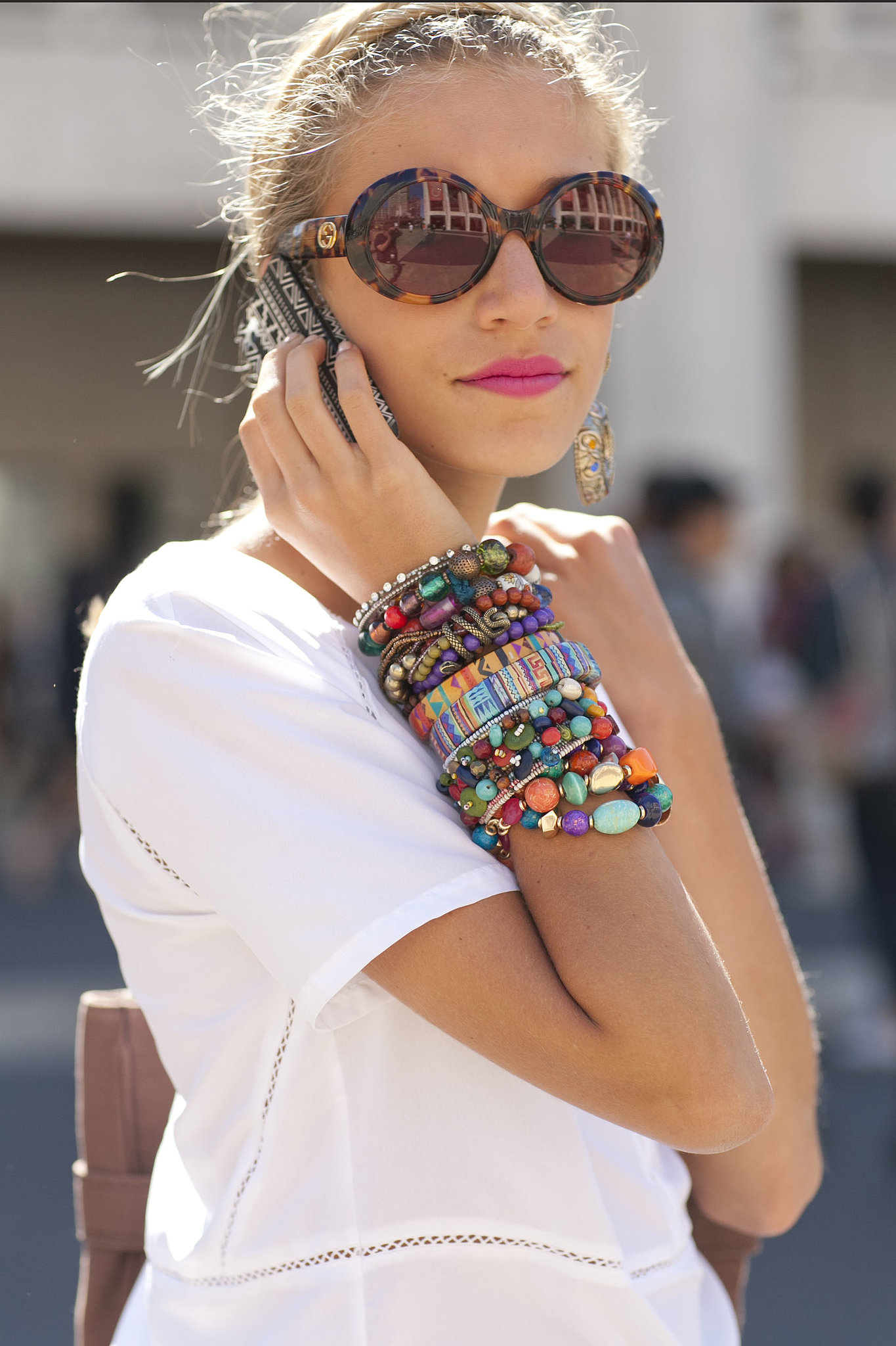 A rainbow-bright wrist and major shades.