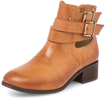 Tan peekaboo buckle boots