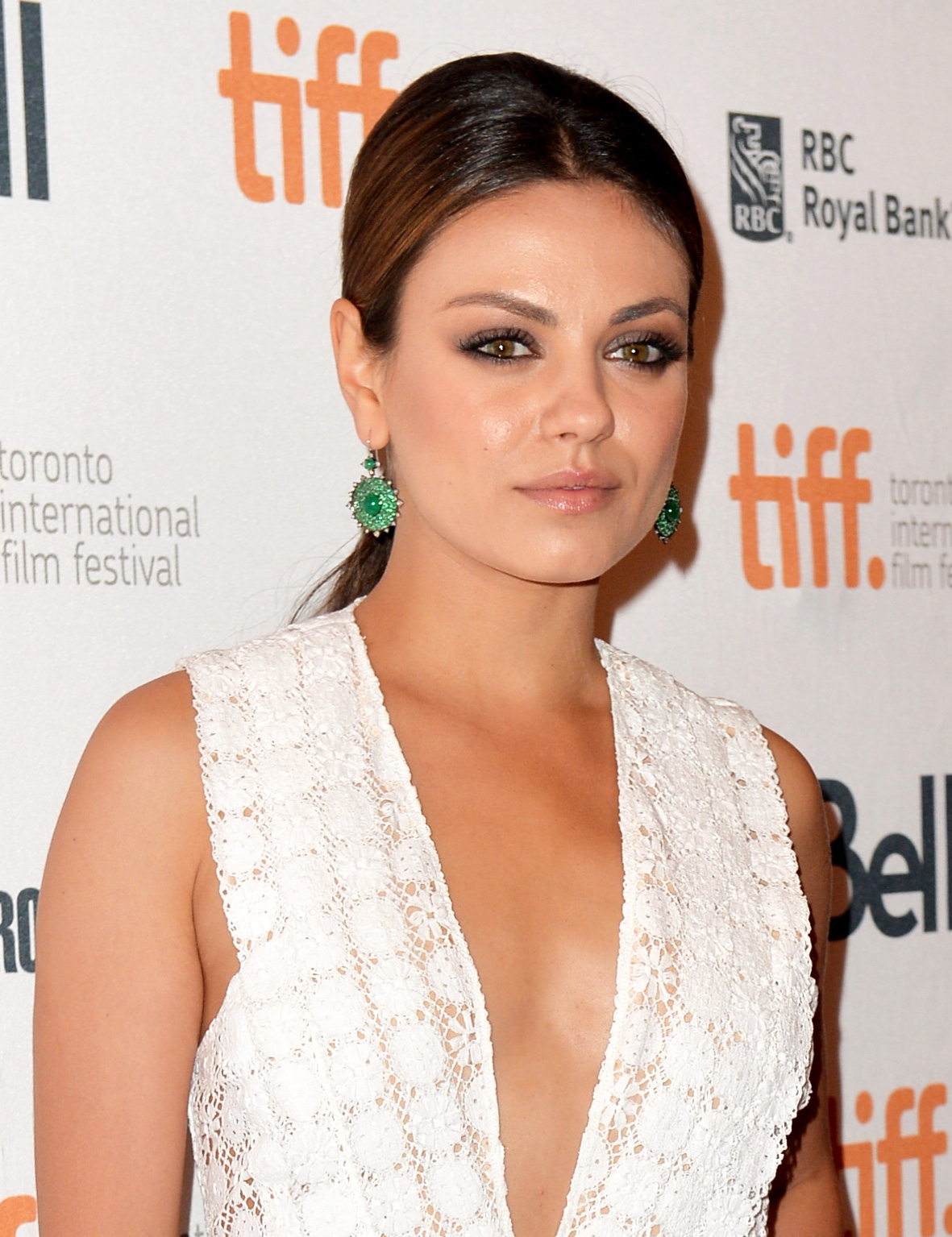 Mila Kunis wore her hair slicked back in a low ponytail at the Third Person premiere. She completed the look with smoky eyes and bold brows.