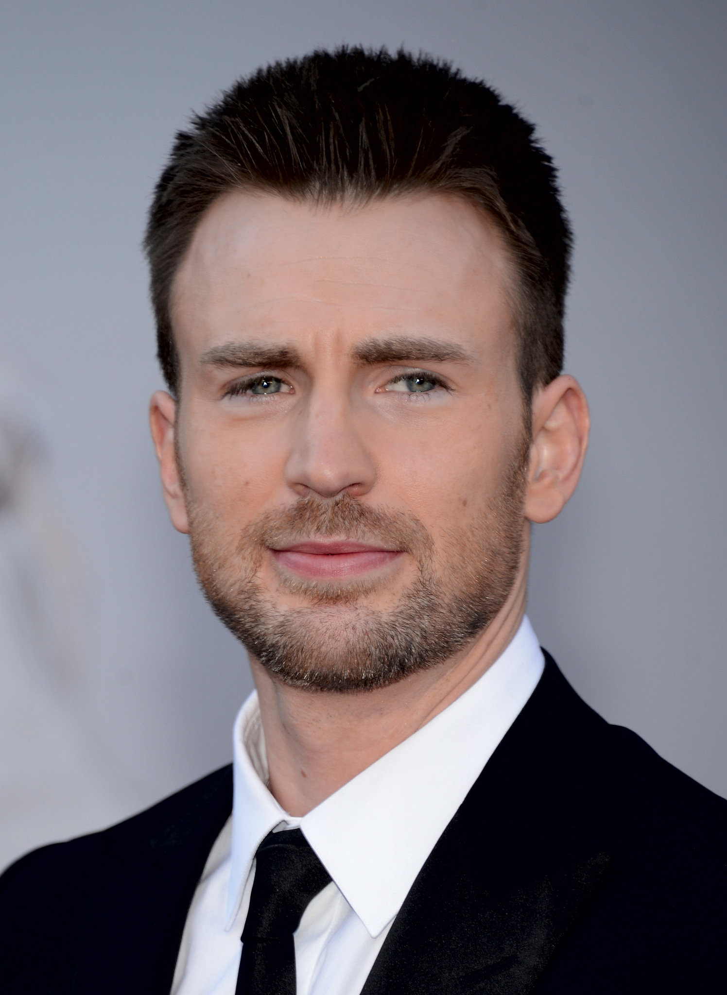 """In 2009, Chris Evans told The Advocate about his brother Scott's coming out: """"We spent the whole day together, got to the city, had some beers in my hotel room, got into a really great talk, and he came out. I was so glad that he did. That's got to be a difficult transition, but I come from the most liberal household you have ever heard of. . . . I think my mother was praying for [both of] us to be gay, so at least she got one of us."""""""
